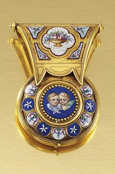 GOLD AND MICRO MOSAIC PENDANT, 1860S.  Designed as a bulla, inset to the obverse with pastel coloured tesserae, depicting floral and foliate motifs and a pair of winged cherubs, the reverse applied with the motif AVE within a surround of multi-coloured tesserae depicting a dove, opening to reveal a glazed locket, Vatican assay marks.