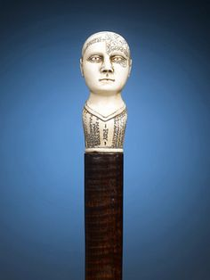 This cane pays tribute to the fascinating study of Phrenology, in which practitioners would read the bumps on the head to determine an individuals personality traits. ~ M.S. Rau Antiques