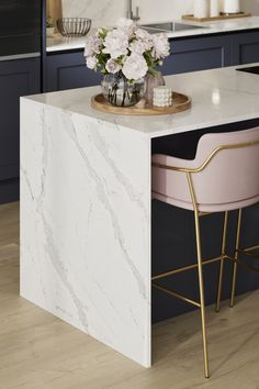Looking for marble countertops ideas? Our Silestone Calacatta Gold Kitchen Worktop looks amazing when paired with blue kitchen cabinets and pale pink bar stools. These marble kitchen countertops are hardwearing and are perfect for creating your modern kitchen design. Navy Blue Kitchen Cabinets, Gold Kitchen, Kitchen Tops, Open Plan Kitchen, Kitchen And Bath, Kitchen Ideas, Quartz Kitchen Countertops, Kitchen Worktops, Silestone Calacatta Gold