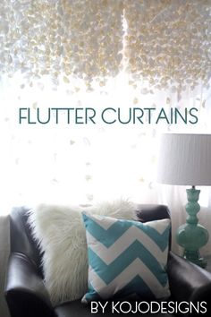 """DIY Curtains: DIY flutter curtains the blogger said she sewed them all on by hand, but if you used two sheer curtains, and stitched vertical """"pockets"""" every 12"""" or so, maybe you could just have strings of them hanging in them in bunches?"""