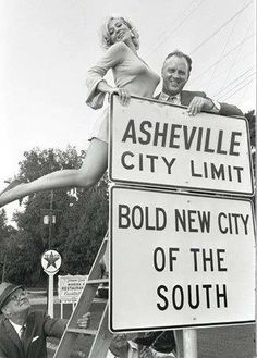 Vintage photo...ASHEVILLE, North Carolina  Kyle is that us?  Inspiration for Cadillac bumper bullets of the 1950's.  What's the guy holding the ladder looking at?