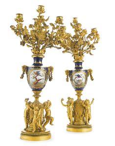 A pair of early Napoléon III gilt bronze-mounted Sèvres style porcelain seven-branch candelabras Paris, mid 19th century | lot | Sotheby's