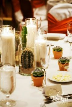 Possibly, one of my favorite centerpieces of all time–a combination of pillar candles, succulents and cactus–simple, elegant with a hint of organic.
