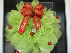 """This beautiful wreath measures about 26"""" by 26"""". It is a full 10 yards of mesh on a grapevine wreath."""