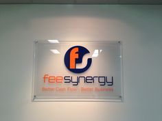 Indoor Reception sign for feesynergy, providers of financial services. Crafted out of individual lettering and vinyl stickers.