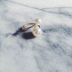 Our haute double pearl adjustable gold ring that goes with Everything. The two freshwater pearls balance sinuously on a 10K gold plated ring -