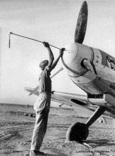 Bf 109 F. Cleaning the gun.
