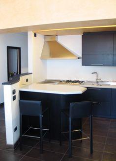 Custom kitchen made of black open pore durmast.