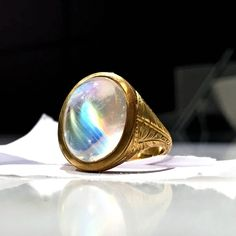 Lilly Fitzgerald Extraordinary Oval Rainbow Moonstone Carved Gold Relic Ring | From a unique collection of vintage cocktail rings at https://www.1stdibs.com/jewelry/rings/cocktail-rings/