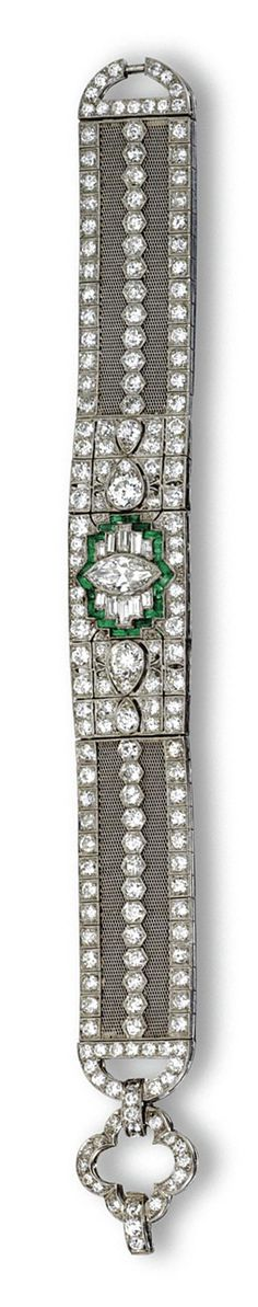 DIAMOND AND EMERALD BRACELET, CIRCA 1925. Designed as an articulated central segment continuing to mesh sides with rounded terminals, the clasp of open quatrefoil shape, set in the center with 1 marquise-shaped diamond weighing approximately 1.35 carats, completed by 184 old European-cut diamonds weighing approximately 12.00 carats and 10 baguette diamonds, accented further with calibré-cut emeralds, mounted in platinum