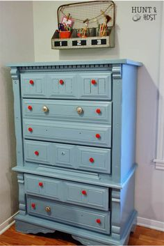 Make it fun. Softer blue with bright red knobs. This dresser makeover is joy for your home. www.huntandhost.com