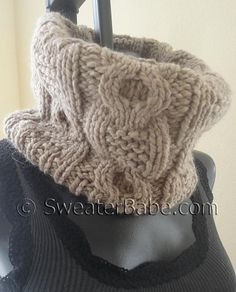 """Pattern Gauge: 20 sts = approx 6 ¼"""" [16 cm] and 18 rnds = 4"""" [10 cm] in Cable patt (blocked)Chunky cables are like chocolate chunks – a good thing made even better by a mere change of proportions!This easy-to-knit cabled cowl features a cool mix of basic cables with some garter stitch thrown in. The alternating cable panels are actually the same, but staggered to create a more interesting result.A super quick knit on size 13 circular needles, this cowl only uses 2 balls of the bulky yarn…"""