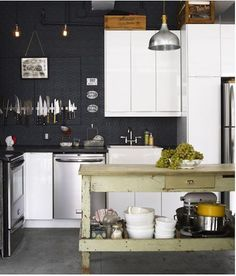 The Brooklyn loft kitchen of Susan and William Brinson of the House of Brinson (first spotted on Design Sponge); William collects vintage kitchenware, specifically knives.