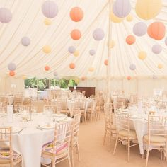 Pretty pastel wedding marquee at Burloes Hall #hertfordshire #wedding #marquee #pastel #paperlantern #lantern #tablesettings #celebration #love #happiness