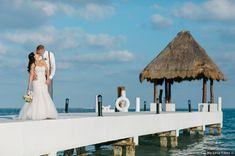 Beautiful wedding photography on ocean boardwalk leading to straw hut