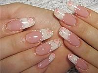 Wedding manicure - french tip nails with pink roses and white dots decoration