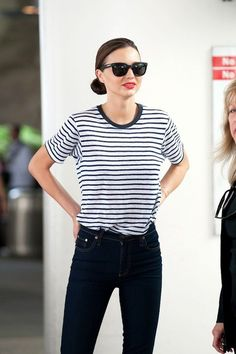 Take a style tip out of Miranda Kerr's book — tucked striped tee in high waisted black jeans.