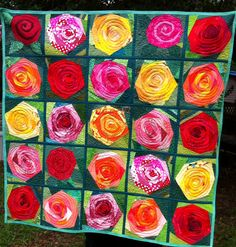 Rose Garden 42x42, a quilt-as-you-go. Used most of my green, red, yellow and orange scraps. Pieced and quilted by Jennifer Martin in Alabama 2017 Given to Karen