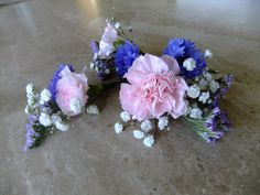 Pretty country style hair flowers in pink and blue