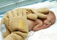 the Zaky. Mimics weight and warmth of human hands. Provides comfort for NICU babies when their parents cannot be there. Also aids in positioning. very cool :)