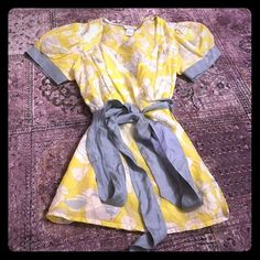 ODILLE Floral Wrap Top This is a gorgeous wrap top from Anthropologie. It a gentle yellow and grey floral pattern and has silver ribbon detail. This is a cotton and silk blend top and the fabric is very thin. A gorgeous piece in excellent used condition! Anthropologie Tops Blouses