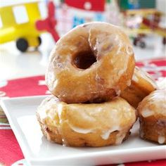"""Sweet Potato-Cranberry Doughnuts Recipe -I grew up near Idaho where they're famous for """"spudnuts,"""" a donut made from mashed potatoes. I reworked a recipe using sweet potatoes flecked with cranberries to come up with these doughnuts. I like to serve them for dessert. —Joni Hilton, Rocklin, California"""