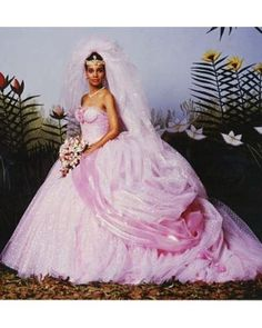 """We're willing to bet Shari Headley would have looked great in anything when her character, Lisa McDowell tied the knot in the 1988 comedy. Costume designer Deborah Landis agreed, saying in an interview with Complex, """"She is every designer's dream, because the more I put on her, the more she could take it. She could carry it. She had that kind of natural elegance. Very much like Audrey Hepburn."""" Funny enough, the fabric Landis used for the wedding dress is an inexpensive nylon tulle. """"She…"""