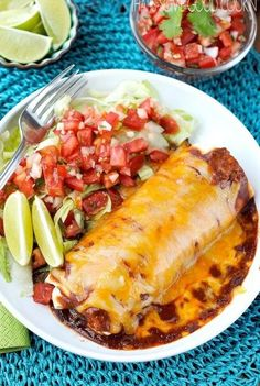 Smothered Burritos -burritos filled with seasoned ground beef, beans and rice, then topped with spicy sauce and lots of cheese Beef Dishes, Food Dishes, Main Dishes, Mexican Dishes, Mexican Food Recipes, Dinner Recipes, Mexican Desserts, Mexican Meat, Smothered Burritos