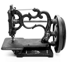 """Sewing Machines have come a long way. ~  (In the exhibit """"Tools of the Trade,"""" the University of Alberta has assembled a fascinating collection of notions and more.)"""
