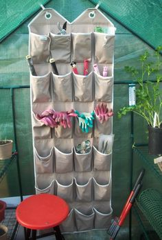 Reuse an old shoe organiser to store small gardening tools & accessories.