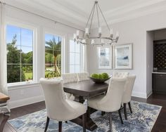 Example of a large transitional enclosed dining room design in Orlando with gray walls and dark hardwood floors