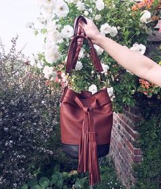 Mimi Bucket Bag - Brown $359 - Handmade 100% real Itailian leather bucket bag with tassel front detail and braided shoulder strap.  Made by me, www.BrittanyMatyas.com