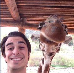 Joey taking selfies with a giraffe