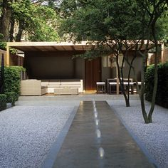 Minimalism to the max: Elegant, structured outdoor spaces are anything but austere when combined with lush, statement greenery. Tim Richardson reveals a generous new approach to geometric garden design