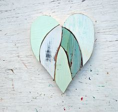 I made this heart from pieces of reclaimed wood. I used mint green, white, baby blue.  Measures 12x11 inches  Hangs by sawtooth hanger  my shop: