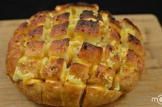 This is just an amazing creation to the bread that I absolutely LOVE, (recipe/160). You have to serve cheesy bread pulls while it is still hot and cheese is all melted...hmm, hmm good. To make it a lighter meal, I would suggest serving it with a fresh green salad and maybe sharing it with other people at the table, lol!