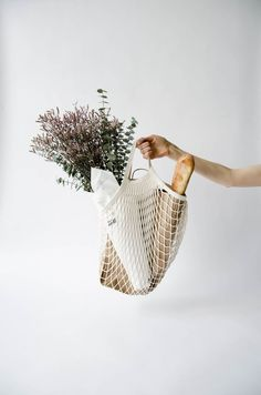 "Since 1860 these Parisian-style net bags have been used in France to gather provisions from markets and grocery stores. We love that these remarkably practical ""filets"" are still relevant and still in use today. Strong, stretchy, compact and useful...just the way we like it. Made in France 100% organic cotton Approximately 15.75"" wide x 15.75"" high Machine washable Colour: natural"