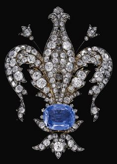 A late-nineteenth-century sapphire and diamond brooch in the form of a fleur-de-lys, symbol of France. (Sotheby's