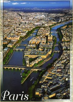 Great shot of Ile de la Cite in the Seine; Notre Dame Cathedral is visible on the far end of the Island.  Pont Neuf, the oldest bridge in Paris, spans the Seine and the tip of the island near the bottom of the photo. JB