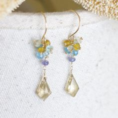 Earrings with champagne quartz, blue quartz, citrine and tanzanite, 14K Gold filled Wire wrapped. $41.00, via Etsy.