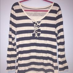 Old Navy. Striped Long sleeve top. Never worn. Old Navy top. Long sleeves. Blue and white stripes. Ruffles down front. Old Navy Tops Tees - Long Sleeve
