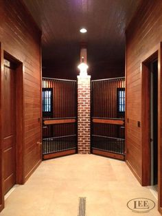 This is a creative angle for these hinged corner stall doors by Lucas Equine Equipment.