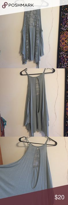 "Free People drape tunic This long and flowing tank top is super cute with lace details! In excellent condition & would be cute over a ivory lace bralette. Hard to find a long tank for the flowy look, this one covers my butt & I am 5'8"" Free People Tops"