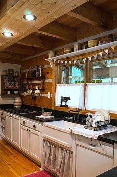 Kitchen , Farmhouse Kitchen Ideas : Farmhouse Kitchen Ideas With White Cabinets And Black Countertops And White Ceramic Sink And Double Handed Faucet And Plates Rack And White Cafe Curtain With Recessed Lighting