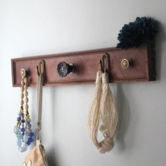20 Awesome Ideas For What You Can Do With Old Dresser Drawers   Use the front of a drawer as a rack to hang things up.
