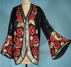 c. 1920's Rare Find Black Sequin Jacket with Huge Deco Sequin Red Roses and Gold Trim!  Most likely French!  Absolutely stunning 1920s sequined evening jacket entirely covered in sequins. The jacket is completely covered in black sequins and decorated with gold and red flowers of sequins. Curved cutaway shape with huge bell sleeves. No closure, just meant to be worn open.