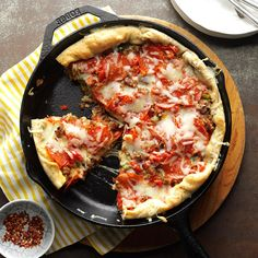 Deep-Dish Sausage Pizza Recipe -My Grandma made the tastiest snacks for us when we stayed the night at her farm. Her wonderful pizza, hot from the oven, was covered with cheese and had fragrant herbs in the crust. Now this pizza is frequently a meal for my husband and me and our two young daughters. —Michele Madden, Washington Court House, Ohio