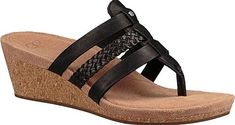 UGG Maddie Wedge Sandal in Black Leather. The UGG Maddie Wedge Sandal will quickly become your warm weather staple. This cushioned cork wedge provides stability with slim leather straps and thong toe. Braided accent strap Imprint by UGG insole Rubber outsole. #footwear #UGG #shoes #wedgesandals #fashion #stylish #style