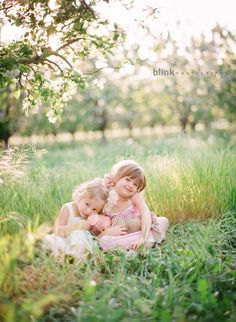 The beauty of new life...sibling newborn session in field.