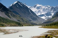 <b>Mt. Belukha Park, Altai Republic, Siberia, Russia</b> - A local boat ferries visitors across glacial Akkem Lake in Mtn. Belukka Park. Belukha is the highest mountain in Siberia, 4499 meters,